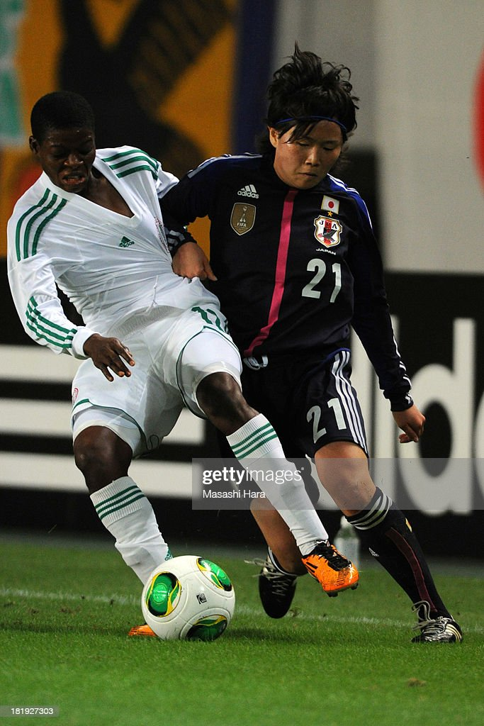 Michi Goto #21 of Japan (R) and Blessing Edoho #12 of Nigeria compete for the ball during the Women's international friendly match between Japan and Nigeria at Fukuda Denshi Arena on September 26, 2013 in Chiba, Japan.