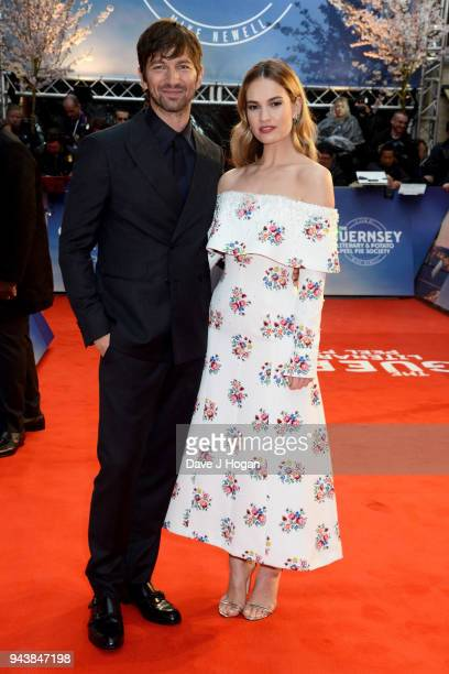 Michiel Huisman and Lily James attend 'The Guernsey Literary And Potato Peel Pie Society' World Premiere at The Curzon Mayfair on April 9 2018 in...