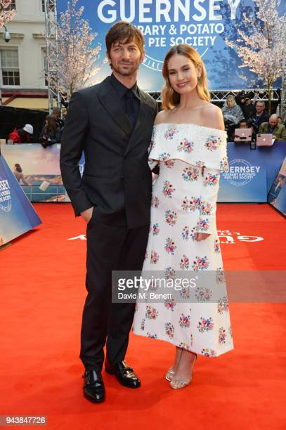 Michiel Huisman and Lily James attend the World Premiere of The Guernsey Literary And Potato Peel Pie Society at The Curzon Mayfair on April 9 2018...