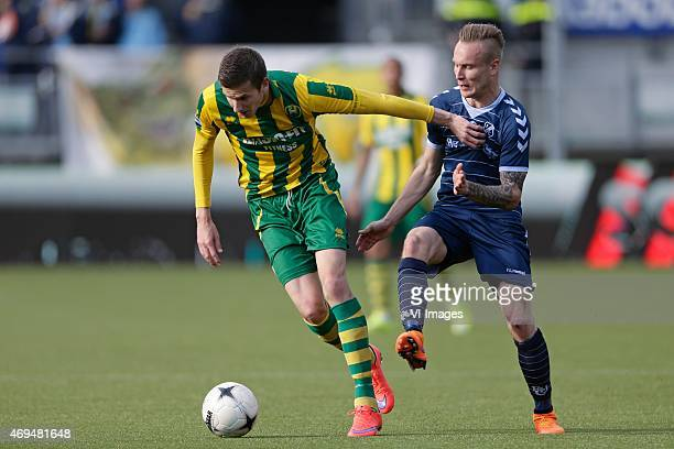 Michiel Kramer of ADO Den Haag Mark Diemers of FC Utrecht during the Dutch Eredivisie match between ADO Den Haag and FC Utrecht at Kyocera stadium on...