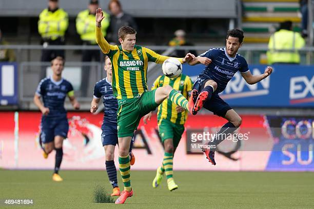 Michiel Kramer of ADO Den Haag Mark van der Maarel of FC Utrecht during the Dutch Eredivisie match between ADO Den Haag and FC Utrecht at Kyocera...