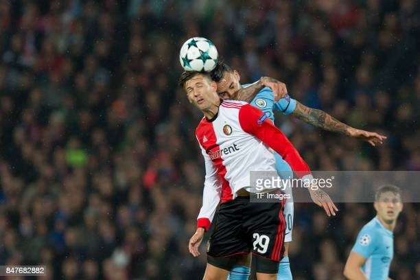 Michiel Kramer of Rotterdam and Nicolas Otamendi of Manchester City battle for the ball during the UEFA Champions League match between Feyenoord...