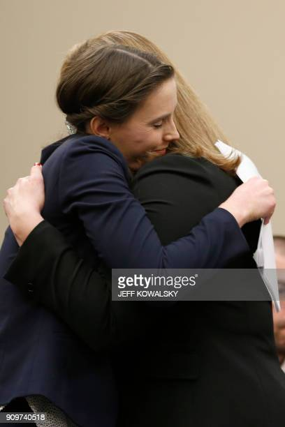 Michigan Assistant Attorney General Angela Povilaitis and Rachael Denhollander embrace as former Michigan State University and USA Gymnastics doctor...