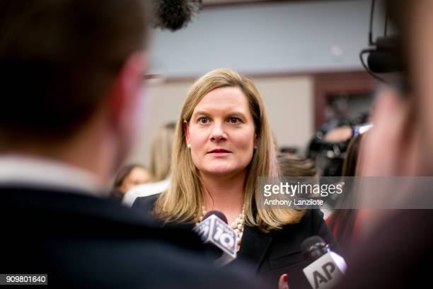 Michigan Assistant Attorney General Angela Povilaitis speaks to the media after the sentencing of disgraced doctor Larry Nassar in Ingham County...