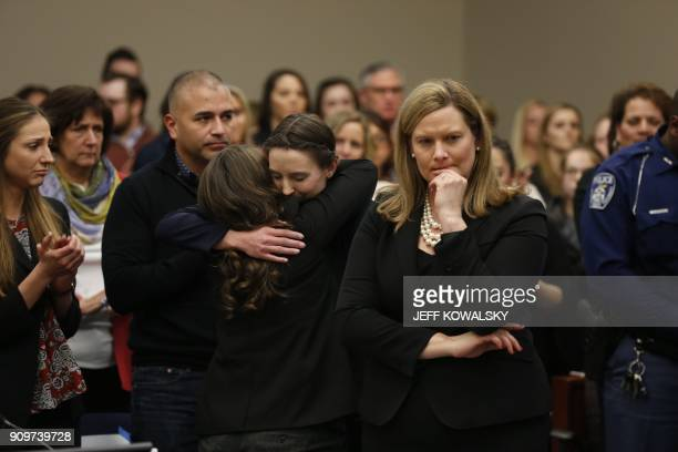 Michigan Assistant Attorney General Angela Povilaitis stands as former Michigan State University and USA Gymnastics doctor Larry Nassar listens...