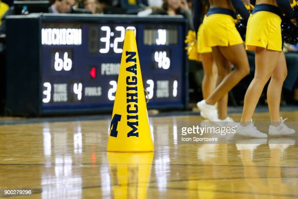 Michigan cheerleader megaphone is seen sitting on the floor during a timeout during a regular season nonconference basketball game between the...