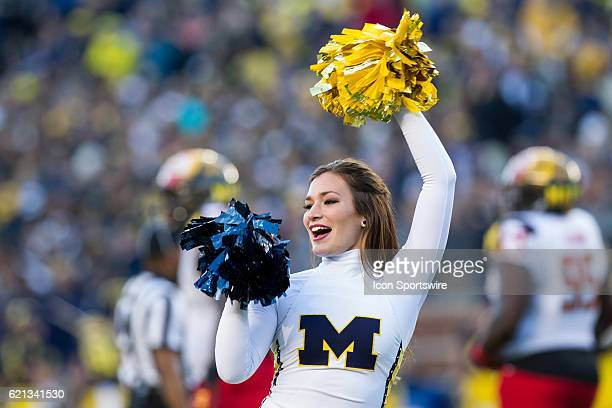 Michigan cheerleader performs during game action between the Maryland Terrapins and the Michigan Wolverines on November 5 at Michigan Stadium in Ann...