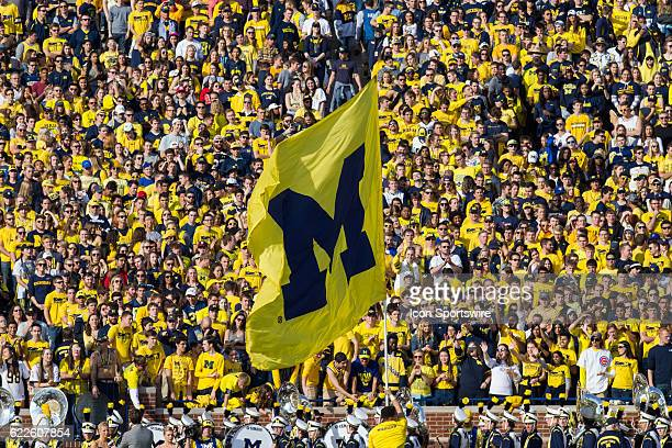 Michigan cheerleader waves the Michigan block 'M' flag prior to the start of the game between the Maryland Terrapins and the Michigan Wolverines on...