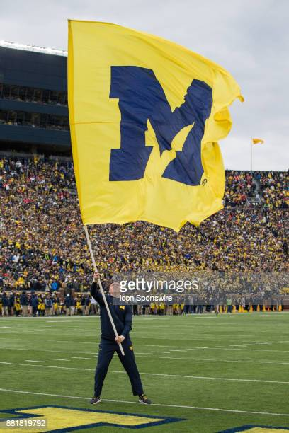 Michigan cheerleader waves the Michigan flag in the end zone after a score during game action between the Ohio State Buckeyes and the Michigan...