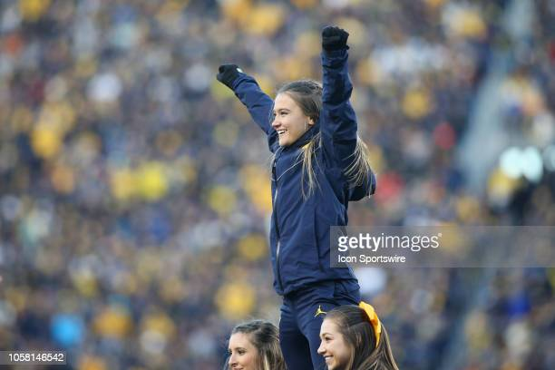 Michigan cheerleaders cheer during a game between the Penn State Nittany Lions and the Michigan Wolverines on November 3 2018 at Michigan Stadium in...