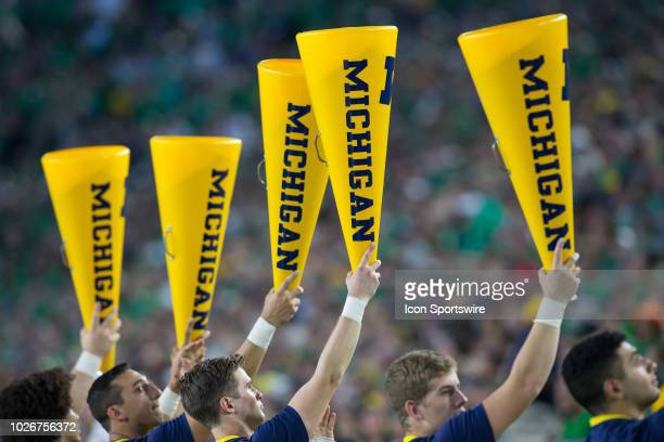 Michigan cheerleaders hold their megaphone up during game action between the Michigan Wolverines and the Notre Dame Fighting Irish on September 1...