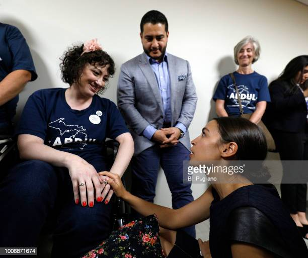 Michigan Democratic gubernatorial candidate Abdul ElSayed and New York Democrat candidate for Congress Alexandria OcasioCortez speak with a supporter...