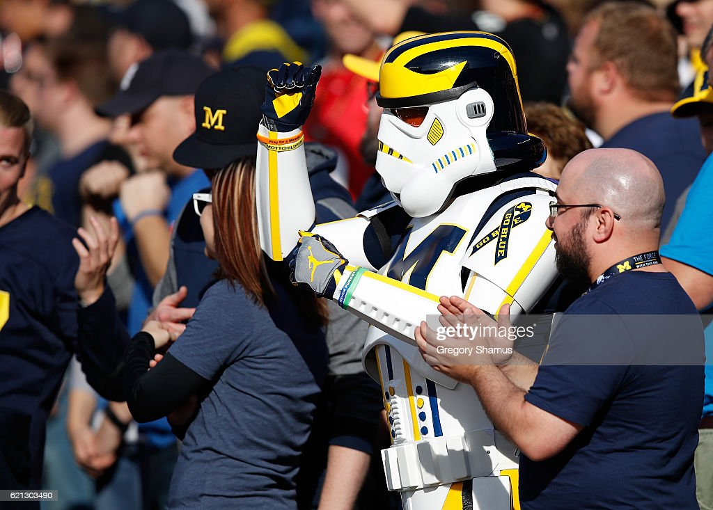 A Michigan fan in a stormtrooper outfit cheers on the Michigan Wolverines while they play the Maryland Terrapins on November 5, 2016 at Michigan Stadium in Ann Arbor, Michigan. Michigan won the game 59-3.