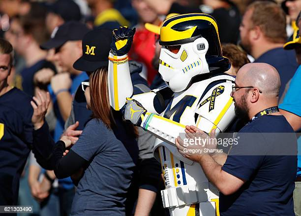 Michigan fan in a stormtrooper outfit cheers on the Michigan Wolverines while they play the Maryland Terrapins on November 5 2016 at Michigan Stadium...