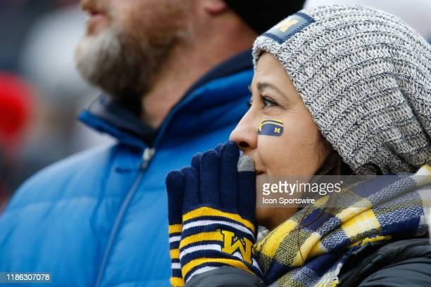 Michigan fan watches the action on the field during a regular season Big 10 Conference game between the Ohio State Buckeyes and the Michigan...