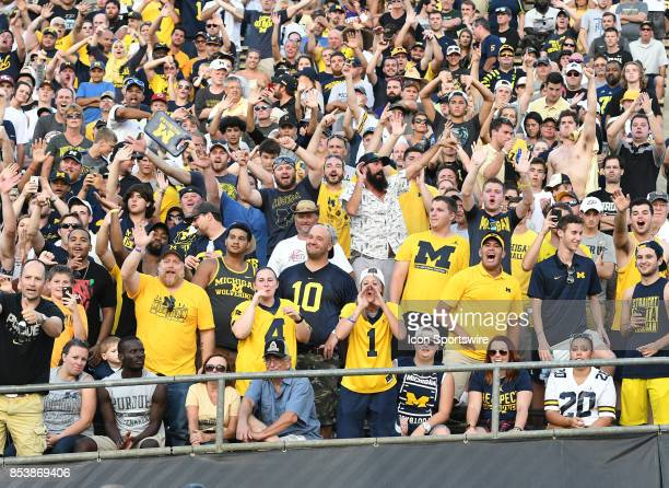 Michigan fans wave goodbye to Purdue linebacker Ja'Whaun Bentley while he was being escorted off the field after being ejected for targeting in the...