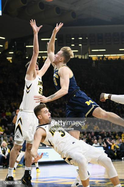 Michigan forward Ignas Brazdeikis charges in to Iowa Hawkeyes guard Jordan Bohannon during a Big Ten Conference basketball game between the Michigan...