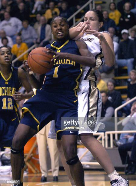 Michigan forward Tabitha Pool grabs a rebound in front of Purdue forwatd Carol Duncan . Purdue defeated Michigan 67-66 at Mackey Arena in West...