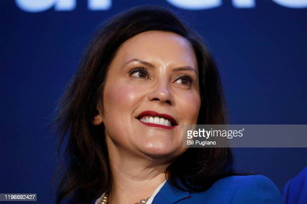 Michigan Gov Gretchen Whitmer stands on stage at an event where General Motors announced that GMs DetroitHamtramck Assembly plant will build the...
