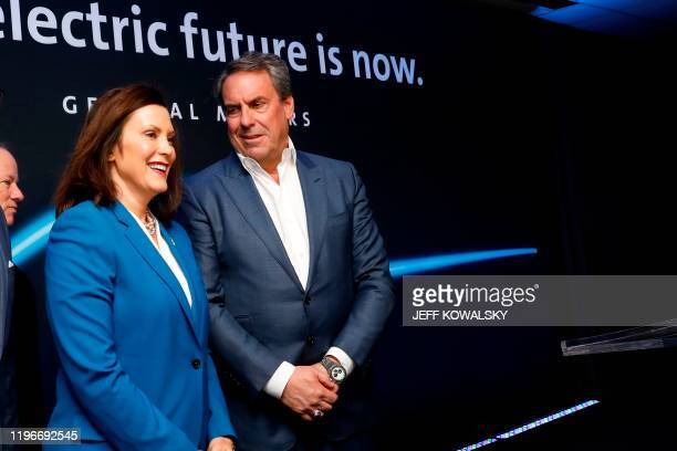 Michigan Gov Gretchen Whitmer talks with Mark Reuss General Motors president at their Detroit Hamtramck assembly plant on January 27 2020 in Detroit...
