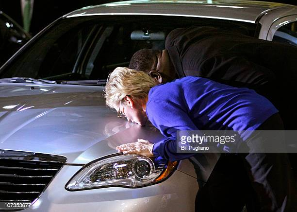 Michigan Gov Jennifer Granholm kisses a allnew 2011 Chrysler 200 during an event that celebrates the latest announcements about Chrysler products...