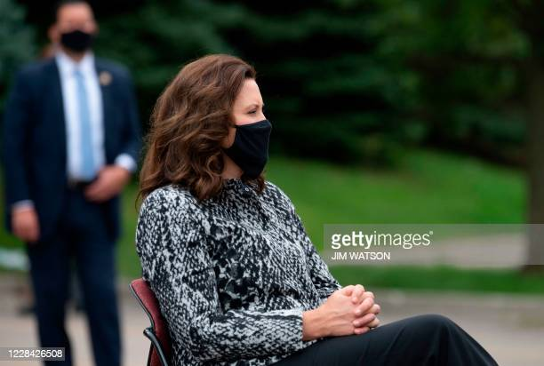 Michigan Governor Gretchen Whitmer listens as Democratic presidential candidate Joe Biden speaks at the United Auto Workers Union Headquarters in...