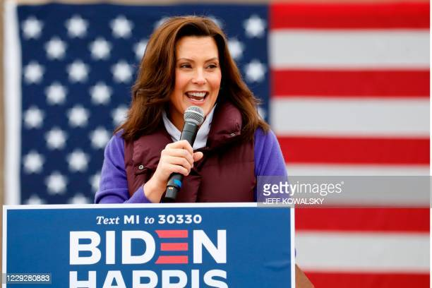Michigan Governor Gretchen Whitmer talks with people as Democratic vice presidential nominee Senator Kamala Harris takes part in a campaign stop at...