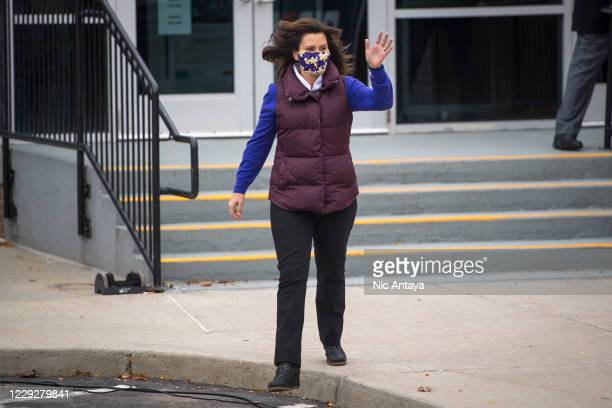 Michigan Governor Gretchen Whitmer waves before Democratic U.S. Vice Presidential nominee Sen. Kamala Harris appears at IBEW Local Union 58 on...