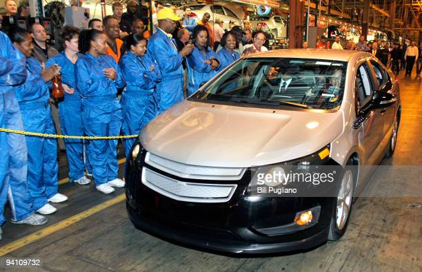 Michigan Governor Jennifer Granholm drives a Chevrolet Volt through the Detroit Hamtramck Assembly Plant to a stage December 7 2009 in Detroit...