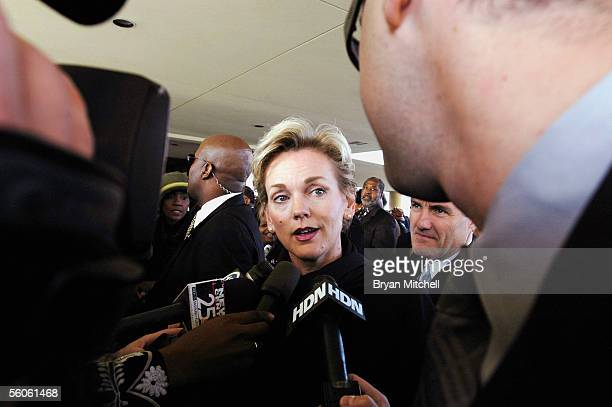Michigan Governor Jennifer Granholm stops to talk with the press as she arrives at Greater Grace Temple she was slated to sing at the funeral service...