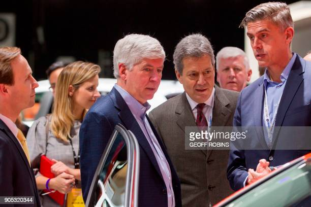 Michigan Governor Rick Snyder tours the Volkswagen stand at the 2018 North American International Auto Show Press Preview in Detroit Michigan on...