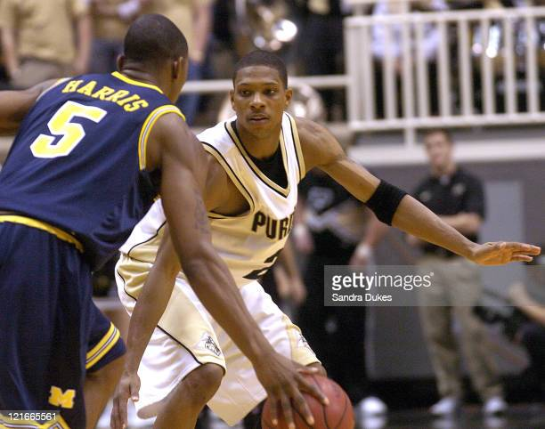 Michigan guard Dion Harris brings the ball upcourt against Purdue guard David Teague Purdue defeated Michigan 8455 at Mackey Arena in West Lafayette...