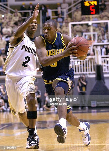Michigan guard Dion Harris drives to the basket against Purdue guard David Teague . Purdue defeated Michigan 84-55 at Mackey Arena in West Lafayette,...