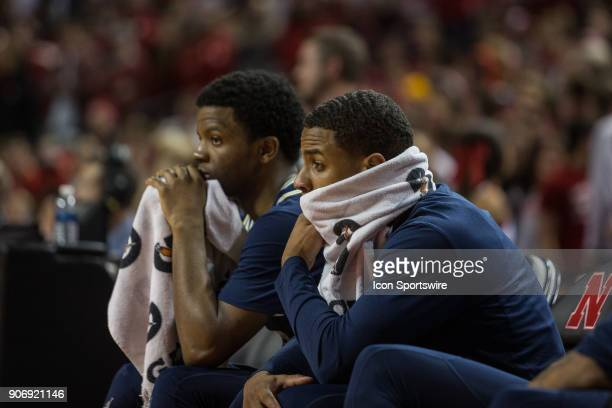 Michigan guard Zavier Simpson and Michigan guard Jaaron Simmons sitting on the bench watching the game against Nebraska get away from them during the...
