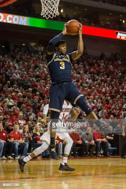 Michigan guard Zavier Simpson grabs the rebound against Nebraska during the first half of a college basketball game Thursday January 18th at the...