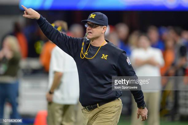 Michigan head coach Jim Harbaugh on the sideline during the ChickfilA Peach Bowl between the Michigan Wolverines and the Florida Gators on December...