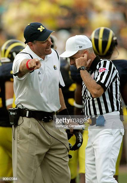 Michigan head coach Rich Rodriguez argues a call with an official in the second half against Notre Dame at Michigan Stadium on September 12, 2009 in...