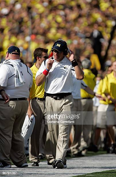 Michigan head coach Rich Rodriguez walks the sidelines against Notre Dame at Michigan Stadium on September 12, 2009 in Ann Arbor, Michigan.