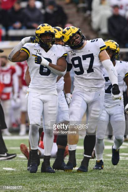 Michigan Josh Uche and Aidan Hutchinson celebrate a sack during a college football game between the Michigan Wolverines and Indiana Hoosiers on...