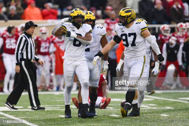 Michigan Josh Uche celebrating a sack by flexing during a college football game between the Michigan Wolverines and Indiana Hoosiers on November 23...