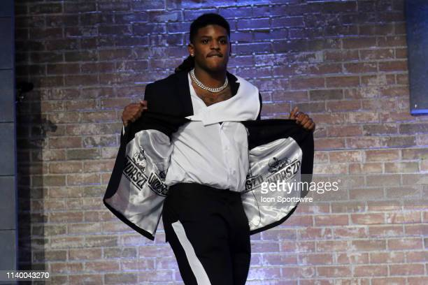 Michigan linebacker Devin Bush is introduced before the first round of the 2019 NFL Draft on April 25 at the Draft Main Stage on Lower Broadway in...
