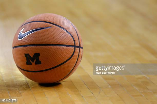 A Michigan Nike basketball is seen sitting on the court during a timeout during a regular season Big 10 Conference basketball game between the Ohio...