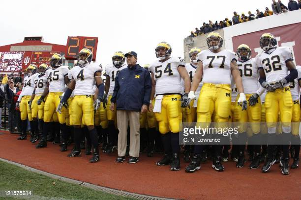 Michigan players and head coach Lloyd Carr wait to run onto the field prior to action between the Michigan Wolverines and Indiana Hoosiers at...