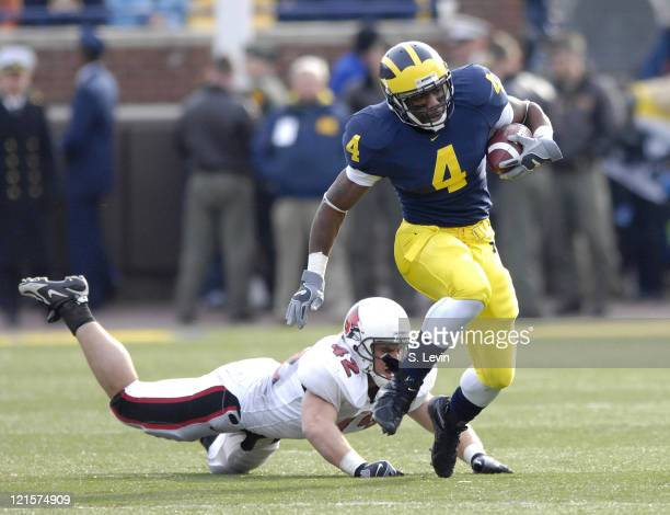 Michigan running back Brandon Minor gets past Ball State linebacker Brad Seiss during the game between the Ball State Cardinals and the University of...
