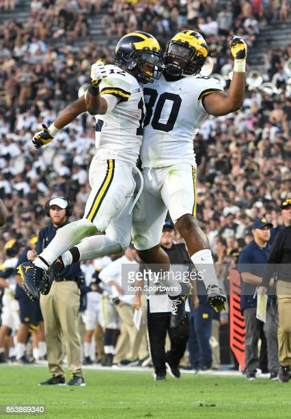 Michigan running back Chris Evans left chest bumps teammate Khalid Hill after scoring a fourth quarter touchdown on a 49yard run during a college...