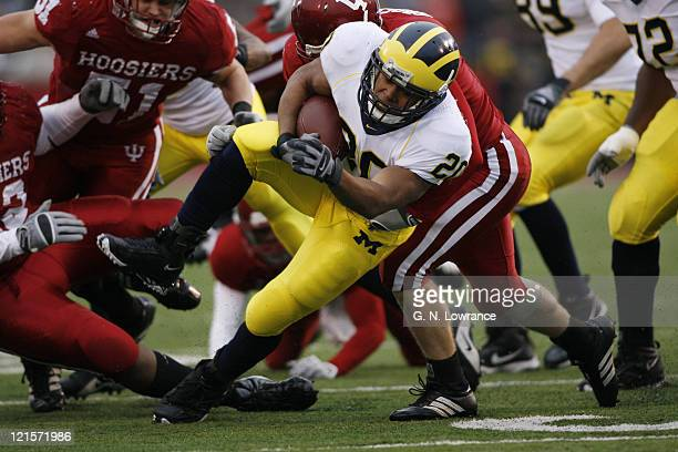 Michigan running back Mike Hart runs for yardage during action between the Michigan Wolverines and Indiana Hoosiers at Memorial Stadium in...
