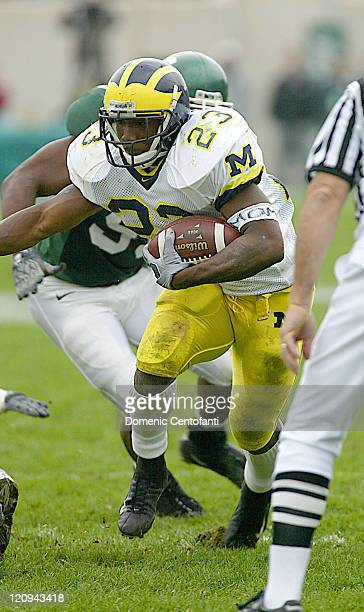 Michigan senior runningback Chris Perry finds a hole against the Michigan State Spartans Saturday November 1 2003 Michigan went on to defeat the...