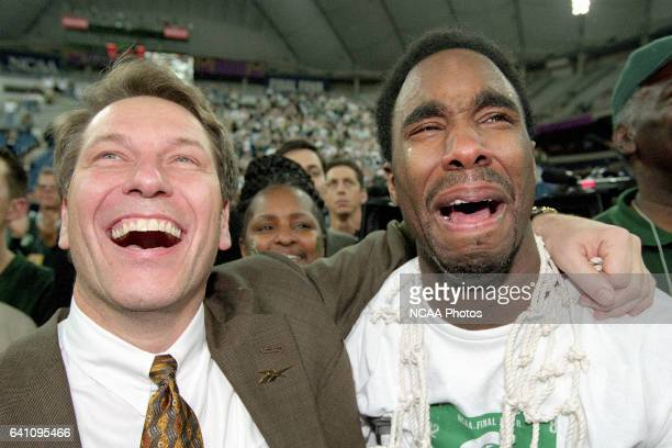 Michigan St. Head coach Tom Izzo and tournament MVP Mateen Cleaves are overcome with emotions after cliniching the title during the NCAA Photos via...
