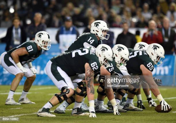 Michigan State Brian Lewerke lines up under center during the Holiday Bowl game between the Washington State Cougars and the Michigan State Spartans...
