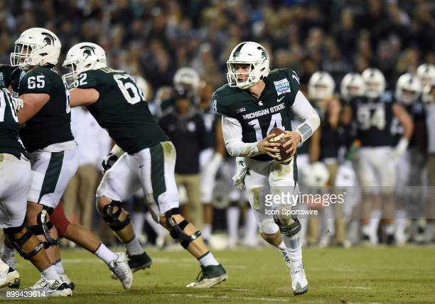 Michigan State Brian Lewerke runs the ball during the Holiday Bowl game between the Washington State Cougars and the Michigan State Spartans on...